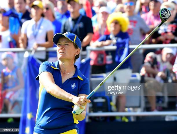 Catriona Matthew of Team Europe watches her tee shot on the first hole in her match against Stacy Lewis of Team USA during the final day singles...