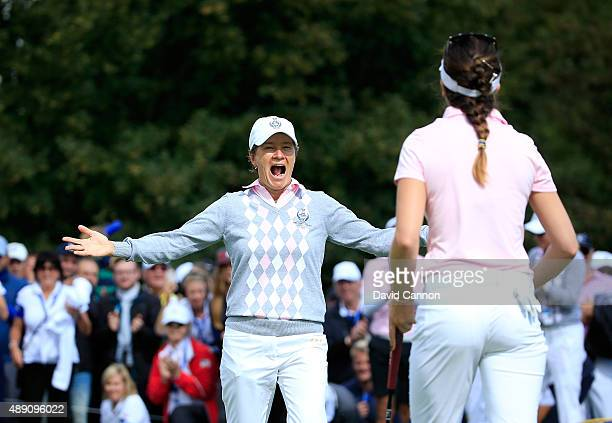 Catriona Matthew of the European Team races to embrace her partner Sandra Gal after Gal had holed a short putt to win their match by 1 hole against...