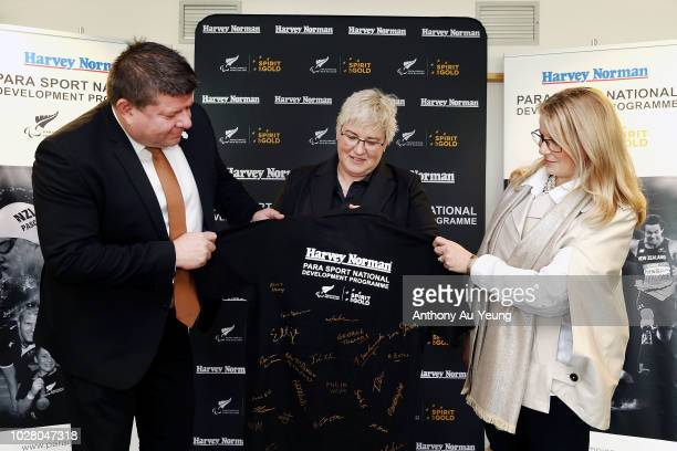 Catriona McBean of Paralympics New Zealand John Hollings and Belinda Smith of Harvey Norman pose for a photo during the Harvey Norman National...