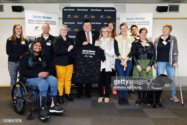 Catriona McBean of Paralympics New Zealand John Hollings and Belinda Smith of Harvey Norman pose for a photo with the Para athletes and programme...