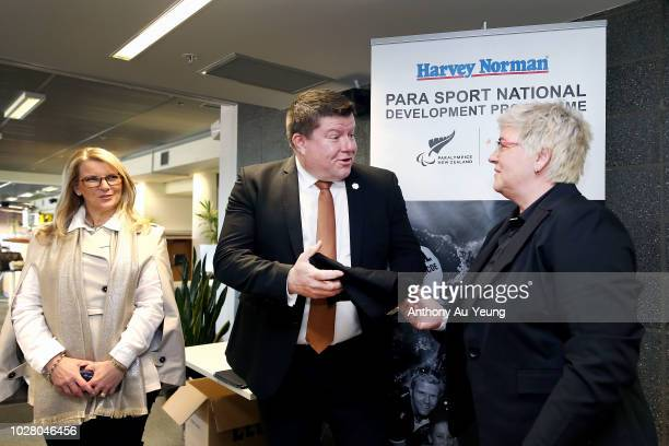 Catriona McBean of Paralympics New Zealand presents a signed shirt to John Hollings and Belinda Smith of Harvey Norman during the Harvey Norman...