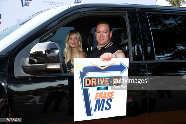Catriona McGinnand and Mark-Paul Gosselaar attend the 27th Annual Race To Erase MS: Drive-In To Erase MS at Rose Bowl on September 04, 2020 in...