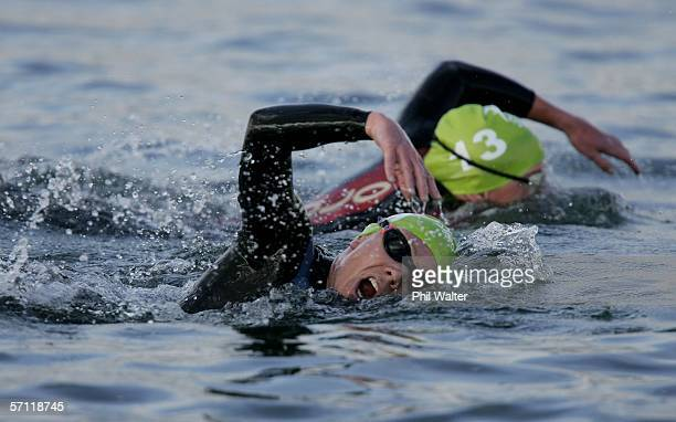 Catriona Morrison of Scotland and Heather Wilson of Northern Ireland compete during the Swim section of the Triathlon Women's Race at the St Kilda...