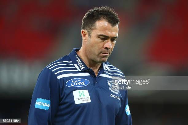 Cats coach Chris Scott looks on during the round seven AFL match between the Gold Coast Suns and the Geelong Cats at Metricon Stadium on May 6 2017...