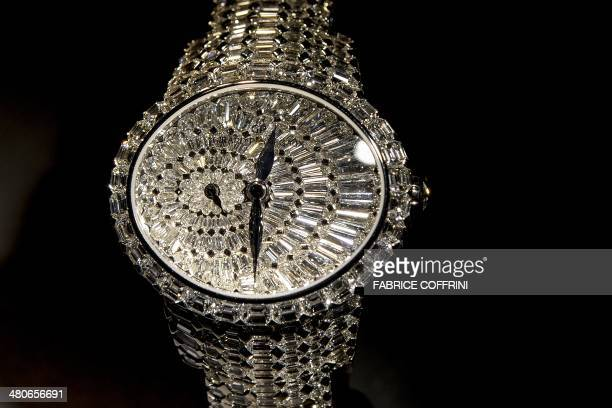 A Cat's Eye by Swiss watchmaker GirardPerregaux with 646 diamonds is displayed at the British jeweller and watchmaker Graff during the media day of...