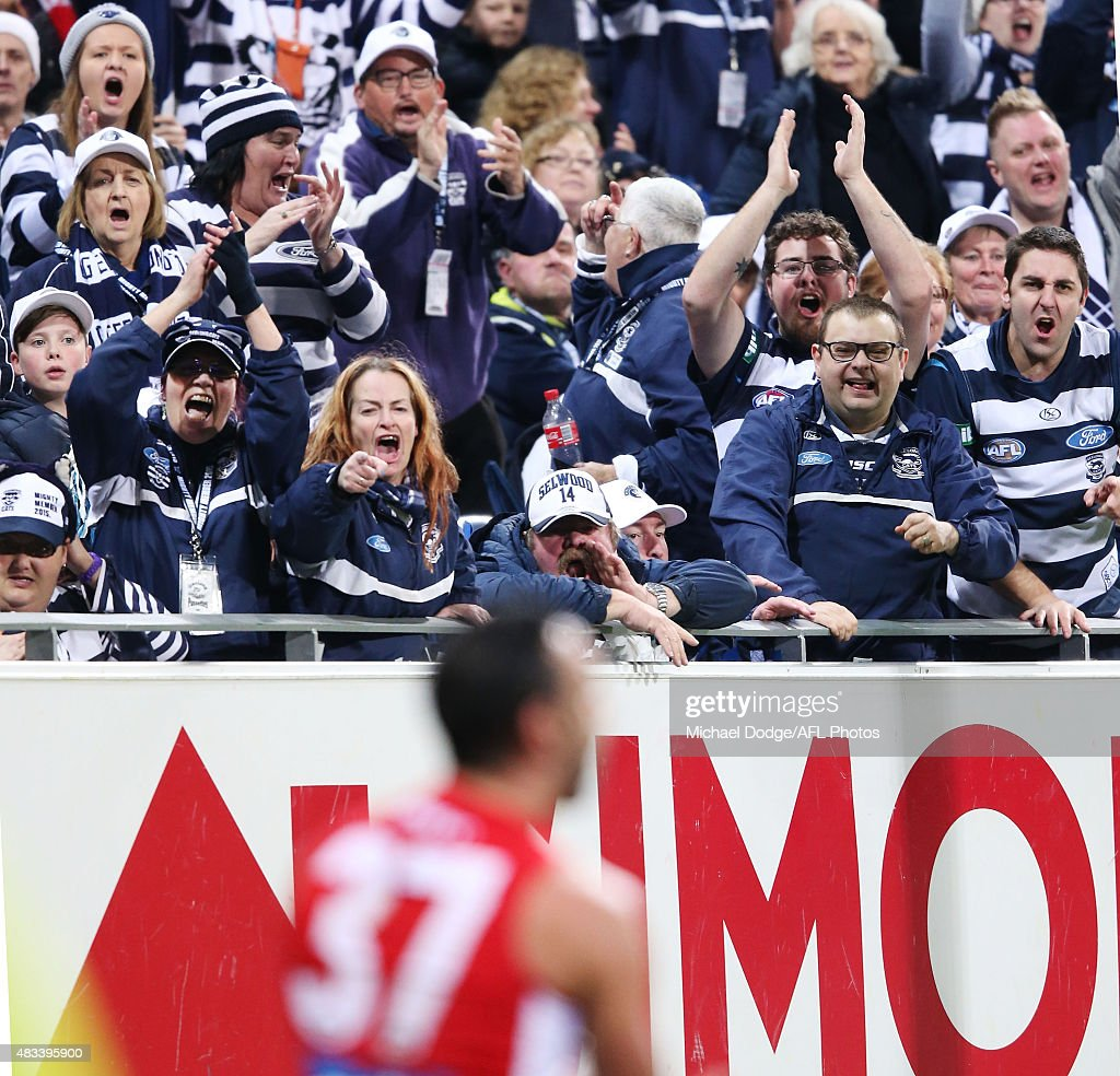 Cats fans react at Adam Goodes of the Swans after he was brought down in a tackle during the round 19 AFL match between the Geelong Cats and the Sydney Swans at Simonds Stadium on August 8, 2015 in Geelong, Australia.
