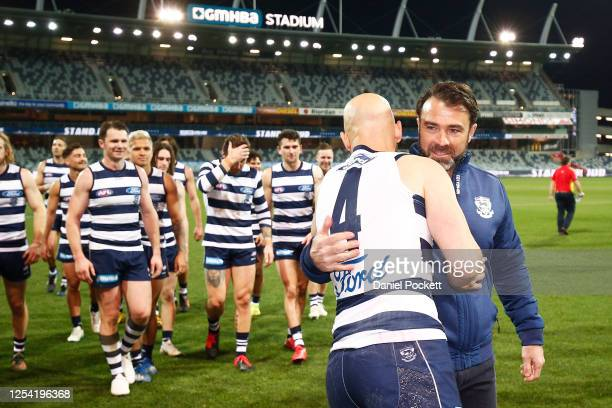 Cats head coach Chris Scott hugs Gary Ablett of the Cats after his 350th game during the round 5 AFL match between the Geelong Cats and the Gold...
