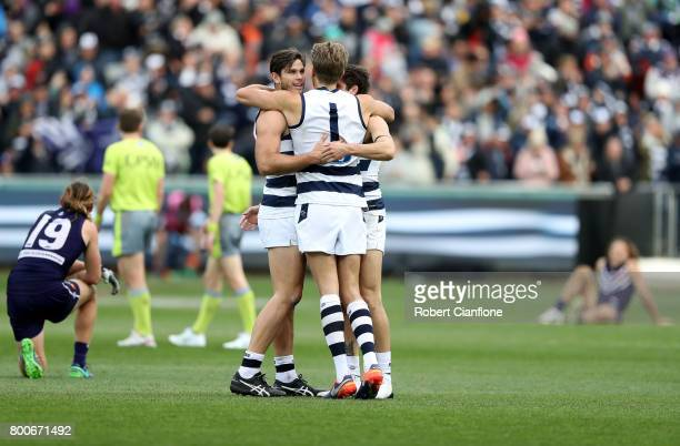 Cats players celebrate after they defeated the Dockers during the round 14 AFL match between the Geelong Cats and the Fremantle Dockers at Simonds...