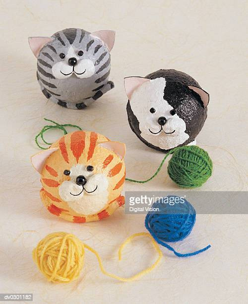Cats with balls of yarn