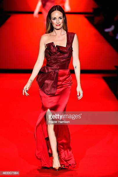 Catt Sadler walks the runway at the Go Red For Women Red Dress Collection 2015 presented by Macy's fashion show during MercedesBenz Fashion Week Fall...