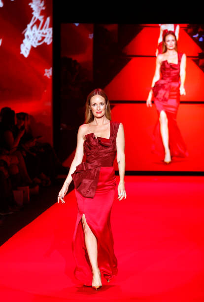 Catt Sandler walks at the Go Red for Women Red Dress Collection during the Mercedes-Benz Fall/Winter