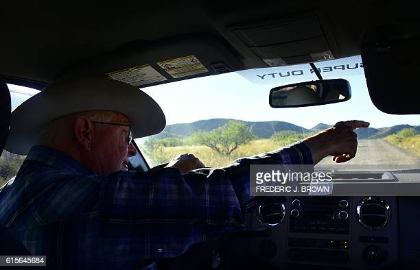Cattle rancher Jim Chilton gestures from his vehicle on a road to the USMexico border from part of his 50000 acre ranch on October 14 2016 some 20...