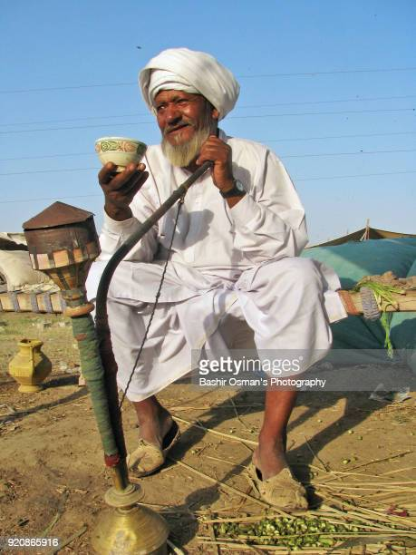 A cattle trader is having tea and hookah