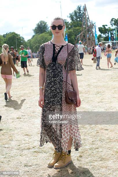 Catwalk model Eloise Showering wears a Zara dress Bag from a market in Glastonbury Caterpillar boots and Sunglasses from Wilderness festival on day 2...