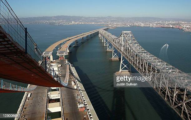 Catwalks hang over a section of the newly constructed eastern span of the San FranciscoOakland Bay Bridge during a media tour of the selfanchored...