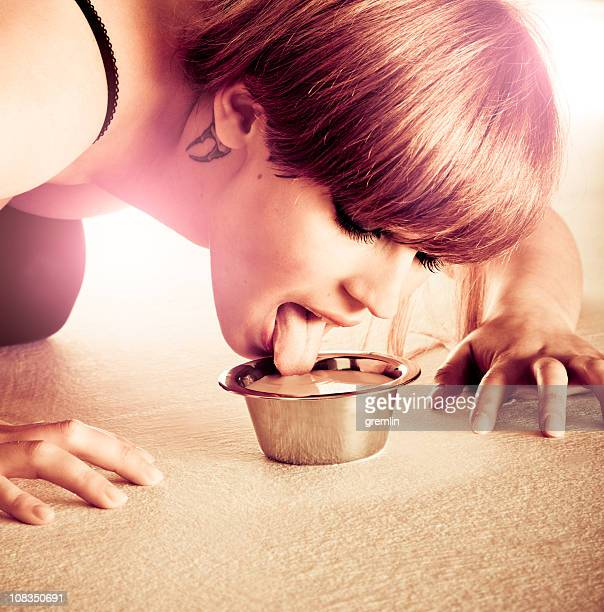 catwoman drinking milk - animal representation stock pictures, royalty-free photos & images