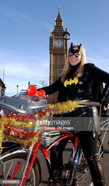 Catwoman sits on a bicycle at the New Year's Day Parade in central London