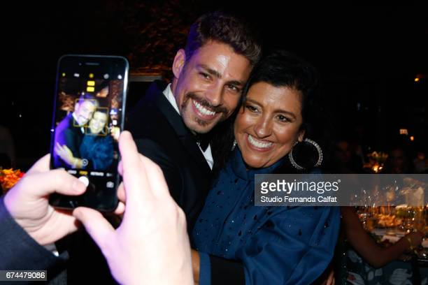 Caua Reymond and Regina Case pose for a photo during the 7th Annual amfAR Inspiration Gala on April 27 2017 in Sao Paulo Brazil