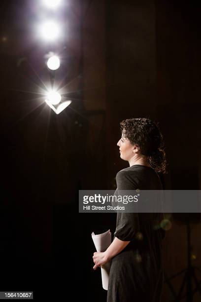 Caucasian actress rehearsing on stage
