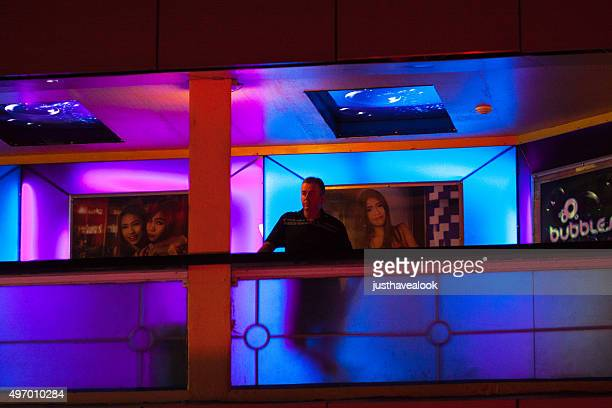 caucasian adult man outside of gogo bar in nana plaza - gogo thai stock pictures, royalty-free photos & images