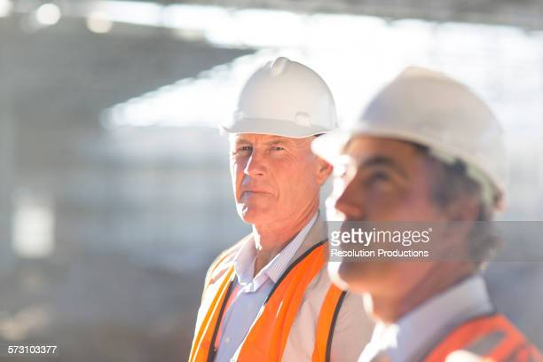 Caucasian architects standing at construction site