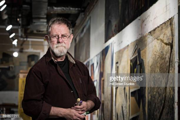 caucasian artist in studio - one senior man only stock pictures, royalty-free photos & images