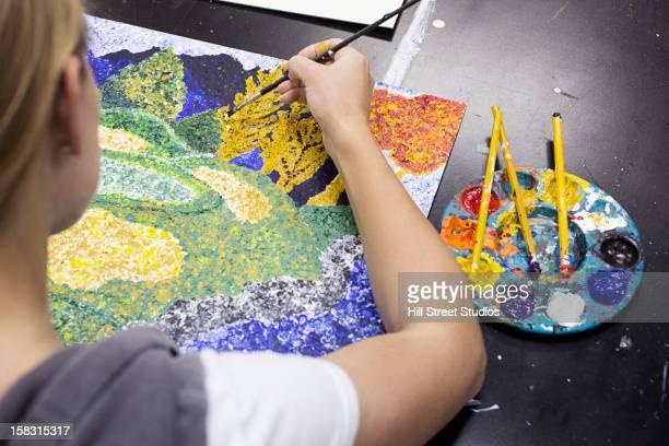 Caucasian artist painting