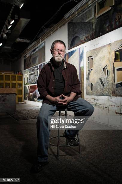 caucasian artist sitting in studio - one senior man only stock pictures, royalty-free photos & images