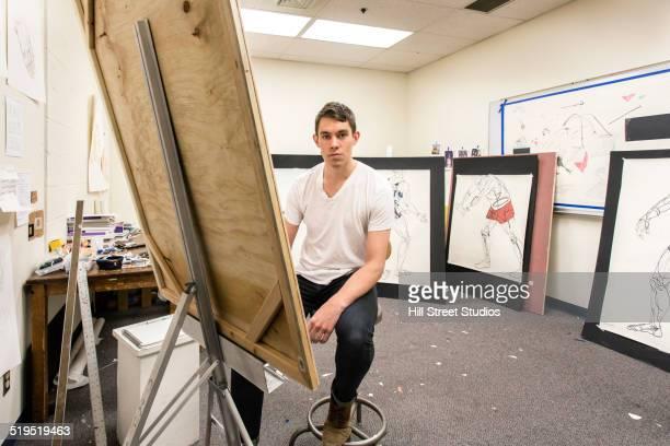 Caucasian artist working in studio