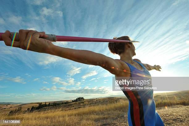 caucasian athlete aiming javelin - やり投げ ストックフォトと画像