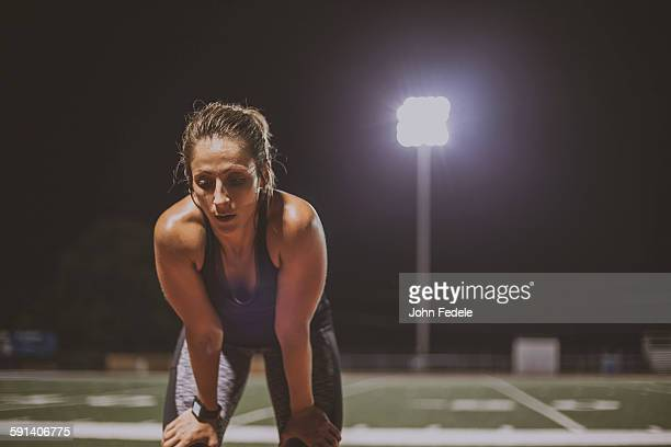 caucasian athlete resting on sports field - atleta imagens e fotografias de stock