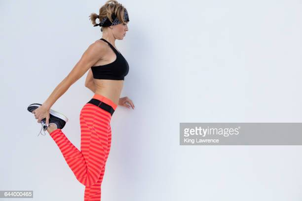 Caucasian athlete stretching leg
