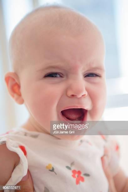 Caucasian baby girl crying
