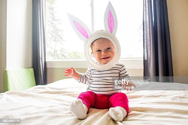 Caucasian baby girl wearing Easter Bunny costume