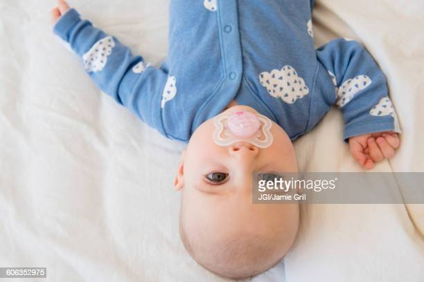 Caucasian baby girl with pacifier