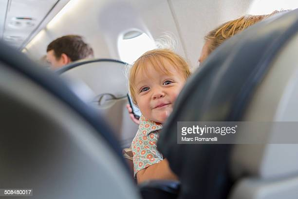 caucasian baby laughing on airplane - southwest usa stock pictures, royalty-free photos & images