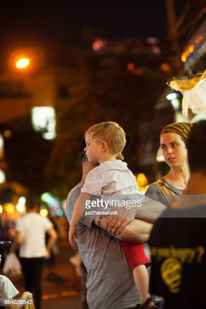 Caucasian backpacker couple with child in Khao San Road
