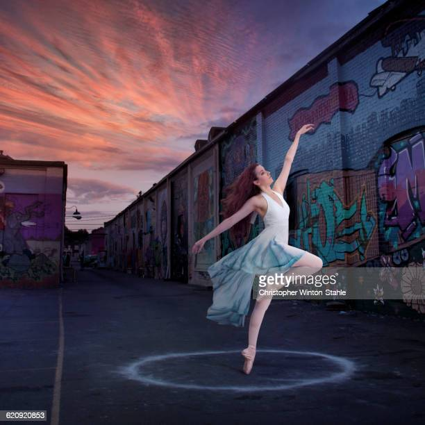 Caucasian ballerina dancing in circle
