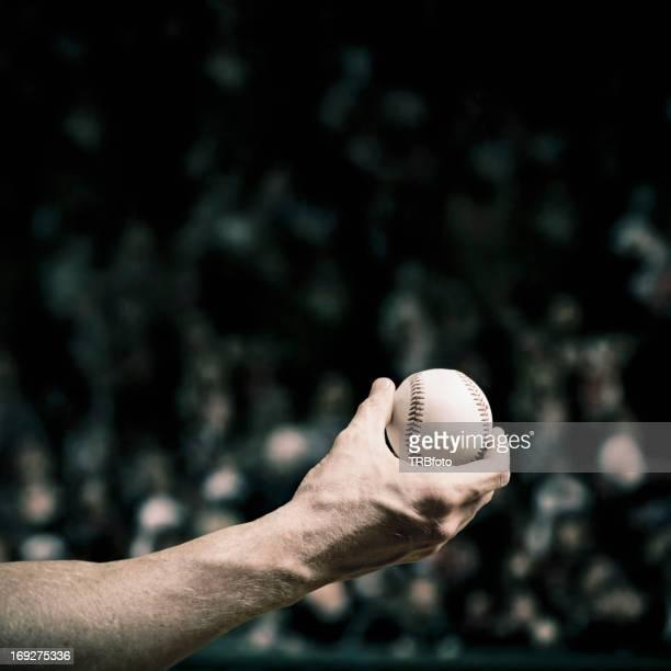 Caucasian baseball player holding ball
