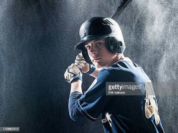 caucasian baseball player standing in rain - batting sports activity stock pictures, royalty-free photos & images