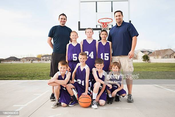 caucasian basketball team smiling court - basketball team stock pictures, royalty-free photos & images