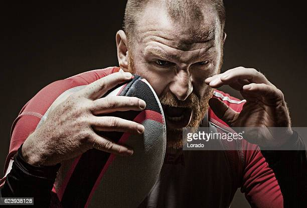 Caucasian bearded redhead adult male rugby player shouting aggressively