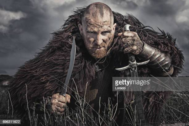 Caucasian Bearded Viking Man in the Dunes at Daytime