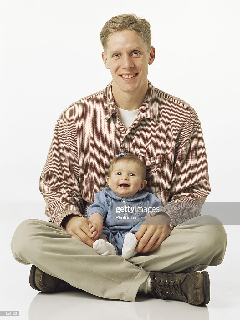 caucasian blonde dad with infant in lap : Foto de stock