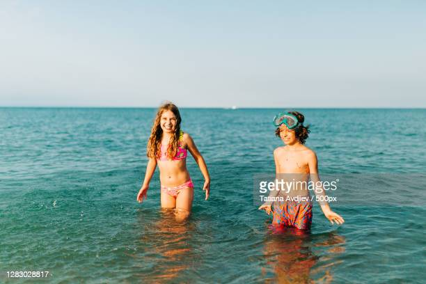 caucasian boy and girl playing in the lake during the summer,kenosha,wisconsin,united states,usa - vilas_county,_wisconsin stock pictures, royalty-free photos & images