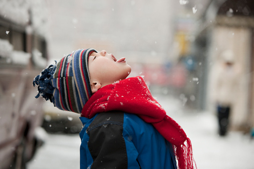 Caucasian boy catching snowflakes on tongue - gettyimageskorea