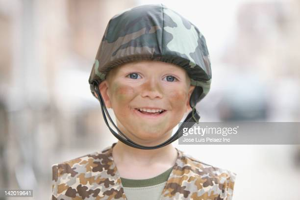Caucasian boy dressed in soldier Halloween costume