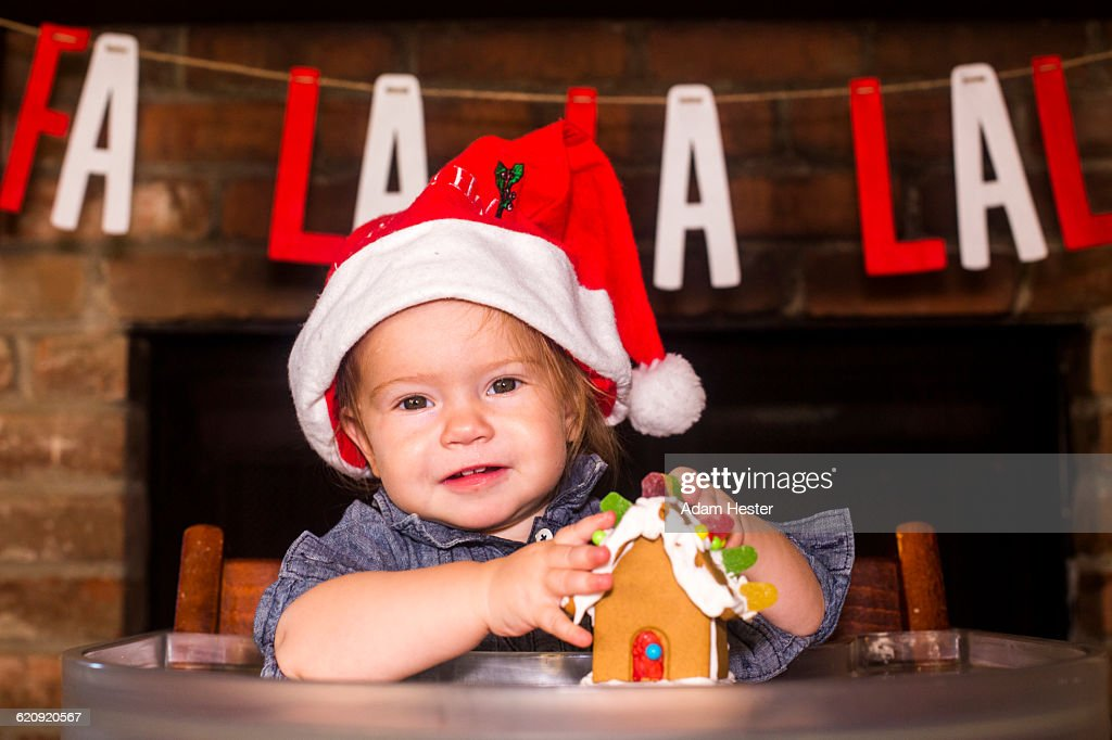 Caucasian boy holding gingerbread house : Stock Photo