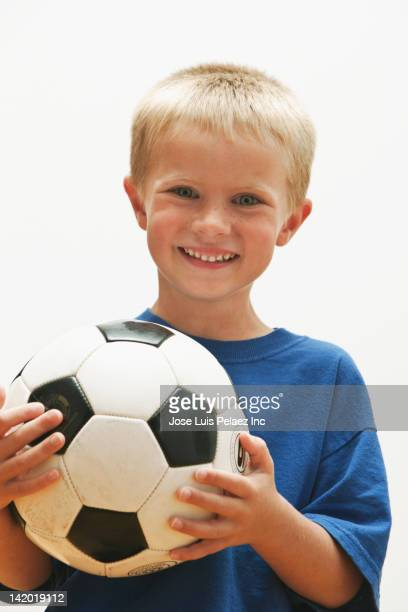Caucasian boy holding soccer ball
