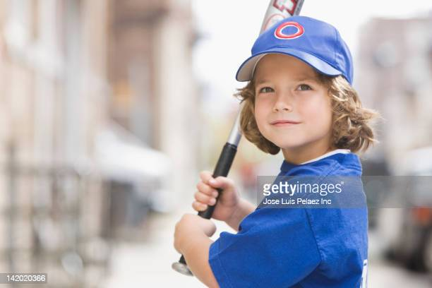 Caucasian boy in baseball uniform
